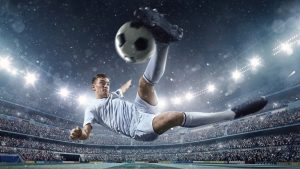A male soccer player makes a dramatic play by jumping horizontally. He attempts to kick the ball with his feet. The stadium is dark behind him. Only the lights of the stadium shine brightly, creating a halo effect around the bulbs. [url=http://www.istockphoto.com/search/lightbox/14599908#196ad674][img]https://lh6.googleusercontent.com/-GdFQEhB66bg/VClu4QW_BKI/AAAAAAAAAuc/89hxSrSE5Fc/s380/SOCCER.jpg[/img][/url] [url=http://www.istockphoto.com/search/lightbox/14599864#18270031][img]https://lh3.googleusercontent.com/-D38pCIGnaRo/VClu4my_I1I/AAAAAAAAAu0/g6eFnALD8h8/s380/SOCCER_BG.jpg[/img][/url] [url=http://www.istockphoto.com/search/lightbox/14599836#164d2c1c][img]https://lh3.googleusercontent.com/-Hd-TF-pojAo/VClu3s6LoQI/AAAAAAAAAu4/ZUdk_NHstFI/s380/ISO_SOCCER.jpg[/img][/url]
